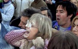 Protesters toss eggs, flour at sister of Argentine president during protest