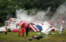 The One-Two-Go plane on the side of the runway after it crashed
