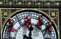 Glaziers abseil down the clock face