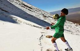 Pte. Morales playing soccer on the mountains