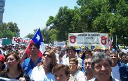 Workers marched through downtown Santiago