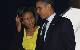 Pte. Obama and his wife Michellearrive at Stansted Airport