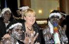Indigenous Affairs minister Jenny Macklin pose with Aboriginal dancers from Arnhem Land