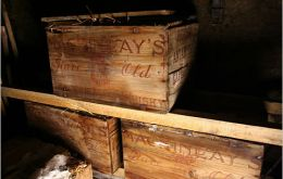Five crates of whisky and brandy were found by the team underneath the floorboards of the explorer's hut