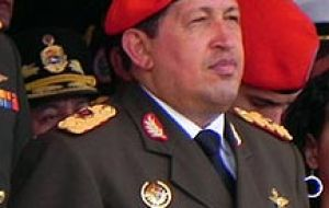 Chavez in full military uniform and red beret