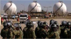 Bolivian soldiers stand watch next to the nationalized companies