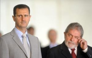 Lula da Silva and his Syrian counterpart Bashar al-Assad  (L)