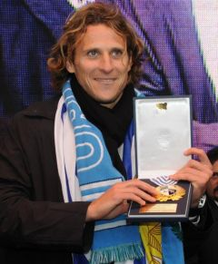 World's Cup's best player Diego Forlan receive a medal with the Uruguayan crest