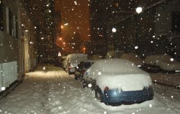 Cars covered in snow in central Chile