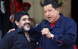 President Chavez next to visiting Argentine coach Diego Maradona on making the announcement