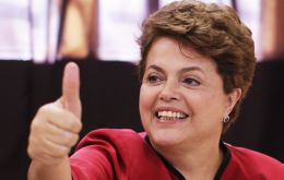 Dilma Rousseff making the victory signal after voting early Sunday
