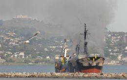 The vessel burning in the bay of Montevideo. (Photo credit El Pais)