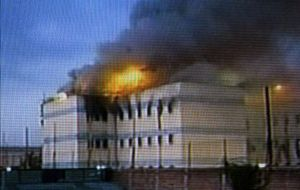 Television footage showed part of the San Miguel prison in flames