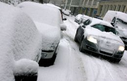 A blanket of snow covers homes, vehicles and roads