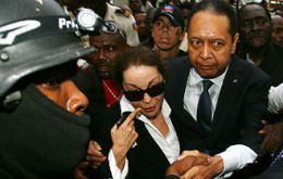 Jean-Claude 'Baby Doc' Duvalier and his partner, Veronique Roy, leave court. (Photo AFP/Getty Images)