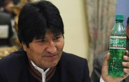 President Evo Morales holds up a bottle of Coca Brynco