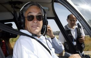 Piñera in his Robinson R44 helicopter