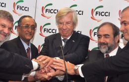 Members of India and Uruguay chambers of commerce celebrate the agreement (The Hindu courtesy)