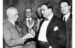 FIFA President Jules Rimet presents the Jules Rimet trophy to Dr. Raul Jude of the Uruguayan Football Association.