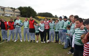 Rugby players with Falkland's children at the School playground
