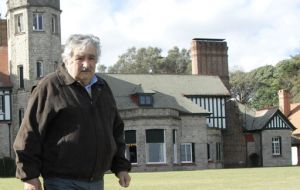 President Jose Mujica up beat on the economy, not so much on politics