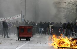 Rioting in the streets of Athens as Parliament voted draconian measures (Photo AFP)