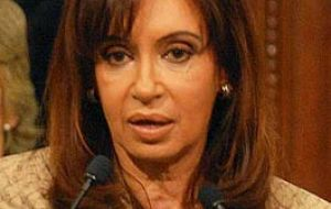 Argentine President Cristina Fernandez responds to criticisms from traditional Peronist chiefs and organized labour