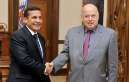 President-elect Humala greeted by OAS head Jose Miguel Insulza