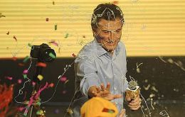 Macri celebrating with his running mate at party headquarters