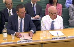 James and Rupert Murdoch testifying at the committee