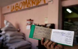 Cubans receive monthly allocations of rice with their ration cards