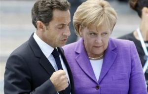 President Nicolas Sarkozy and German Chancellor Angela Merkel united in support of the Euro