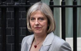 Home Secretary Theresa May cut short her holiday and said there is no excuse for 'thuggery'