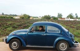 President Jose 'Pepe' Mujica at the wheel of his Beetle