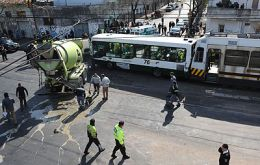 Aerial view of the accident, the bus squashed by the urban train
