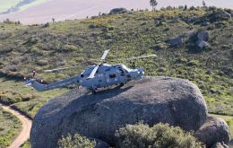 HMS Edinburgh's Lynx lands on a large boulder whilst conducting training with the South African Air Force's Super Lynx