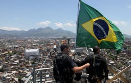 The Brazilian flag flies over Rocinha, the most notorious favela which is home to 150.000 people