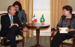 President Rousseff (R), as Mexico's Calderon prepared to help Uruguay