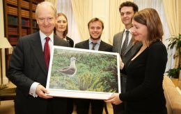 Minister Bellingham with an image of a yellow-nosed albatross