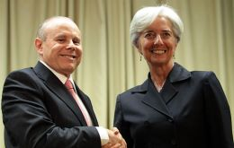 IMF chief Lagarde (R) with Finance minister Mantega