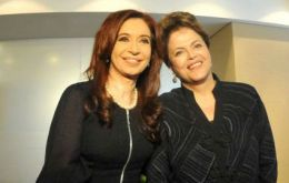 Cristina Fernandez and Dilma Rousseff share smiles in the official picture