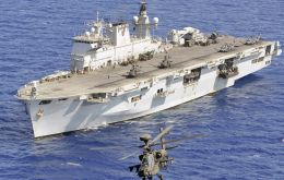 HMS Ocean, the largest ship in the Royal Navy's fleet, which will be berthed in the Thames at Greenwich