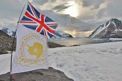 The Union Jack and the team's flag flying in Antarctica