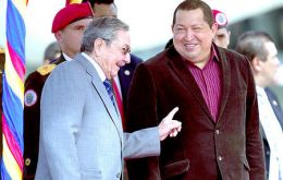 President Chavez receives Raul Castro (L) in Caracas