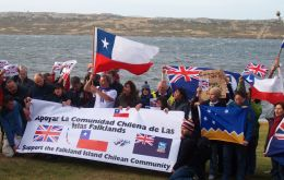 Chileans sang their national anthem and together with Islanders displayed the three flags