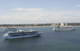 Several cruise vessels in the Bay of Maldonado waiting to land thousands of visitors