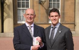 A proud Richard OBE next to his son Sam outside Buckingham Palace