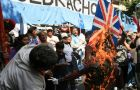 Protestors burn a Union Jack during the clashes next to the British Embassy
