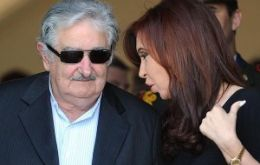 Cristina Fernandez and president Mujica at the Olivos residence for another round of talks