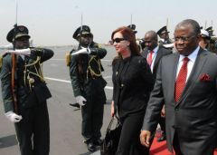 President Cristina Fernandez is met at the airport by Angolan officials